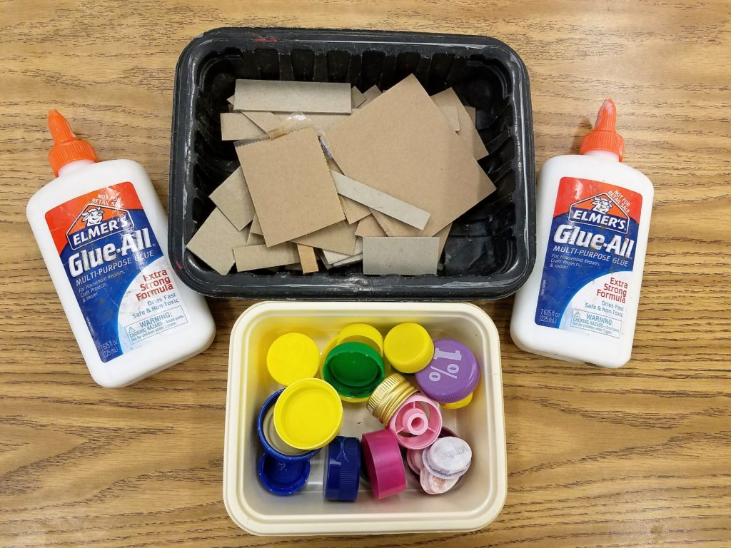 setting up supplies for recycled robot craft