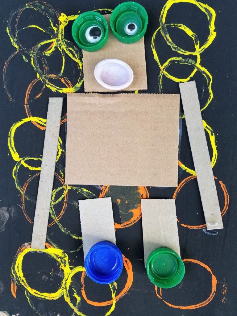 Teach shape recognition and uses to kids with recycled robot art!