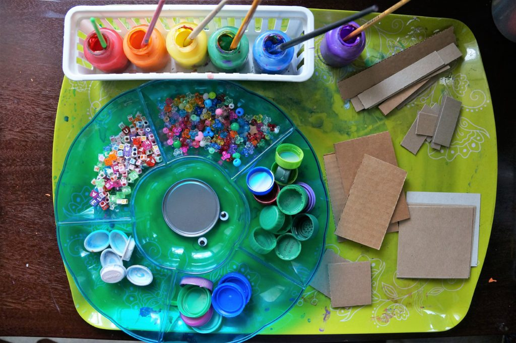 Recycled robot art is used to teach shapes to kids! Here are the basic supplies you will need.