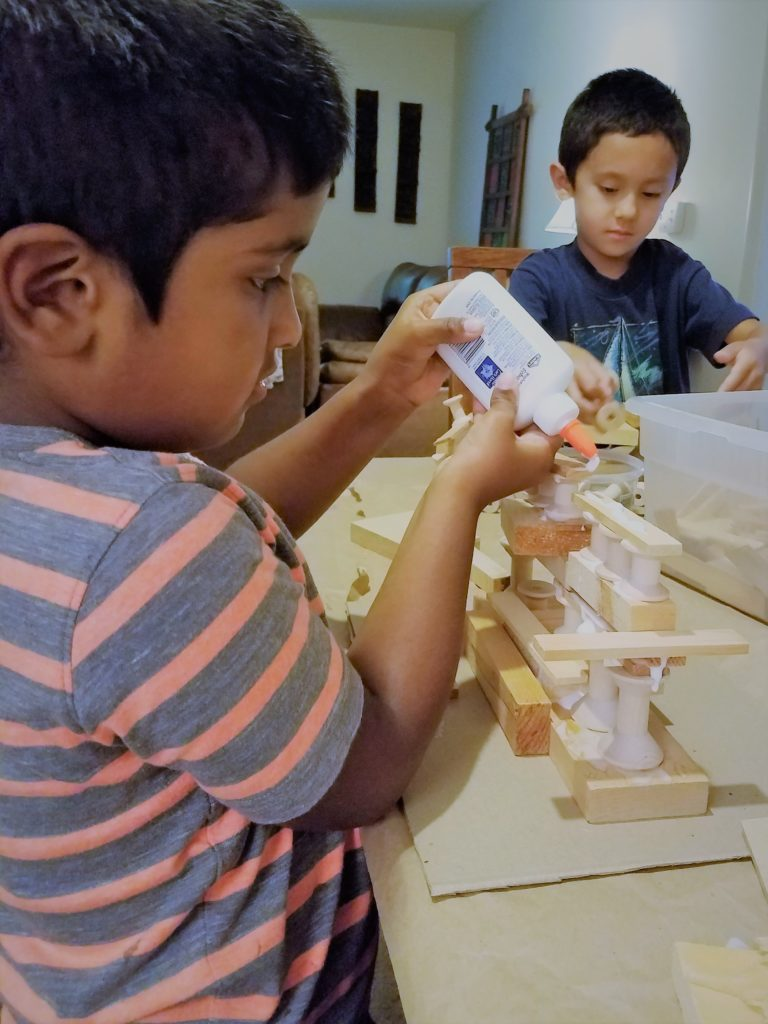 Building with wood for a kid's playdate that is easy and fun for both parents and kids!